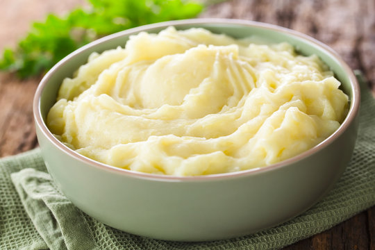 Fresh homemade creamy mashed potato in bowl (Selective Focus, Focus one third into the potato puree)