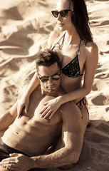 Poster Artist KB Attractive couple relaxing on a tropical island