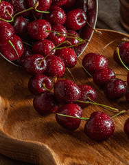 fresh cherries in a bowl on wooden table