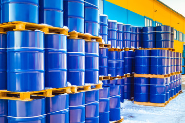 Plastic containers palletized near the stock. Barrels for toxic substances. Chemical storage tanks. Barrels for shipment from stock. Transport of hazardous liquids. Warehouse work. Chemical industry. Fototapete