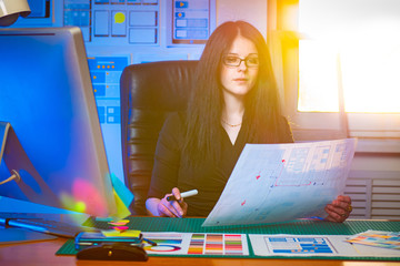 Web design. Girl graphic designer estimates a draft layout of the mobile application. Prototyping in software development. Layout visualization of the web application. Web projecting.