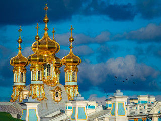 Saint Petersburg. Russia. Golden domes of the Palace against a stormy sky. Cultural monuments of Russia. Leningrad region. Pushkin. Architecture of St. Petersburg. Petersburg travelling.