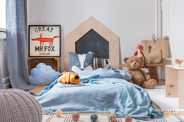 Blue boy's bedroom with toys and wooden furniture, real photo with mockup