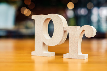 PR Alphabet on Blur Background (Public Relations)