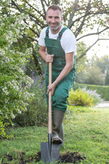 man with a shovel in the garden
