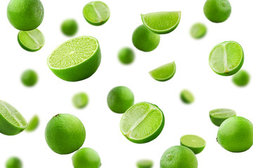 Falling lime isolated on white background, selective focus Wall mural