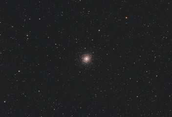 Messier 92 globular cluster in Hercules constellation, with many stars as background in the deep space.