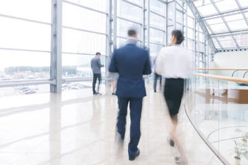 Business people walking in hall