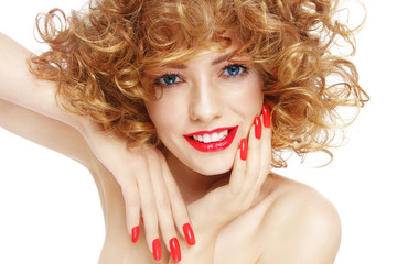 Young beautiful smiling woman with curly hair and nail extensions