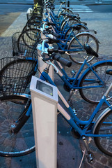 Row of city bicycles for rent.