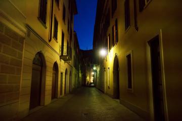 Illuminated lonely street at night.