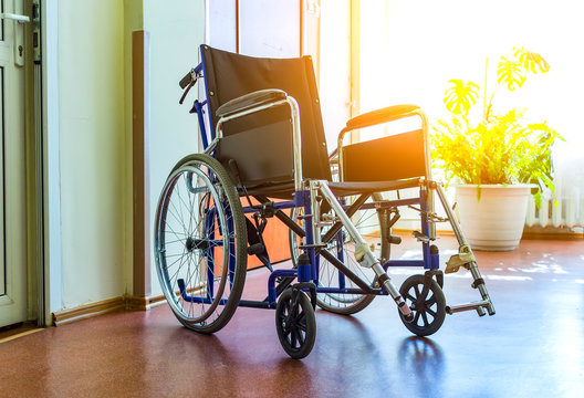 wheelchairs to disabled people in room with parquet floor