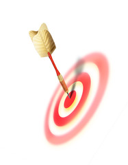 Bullseye, on target, goal met concept image with dart in the center of the target