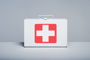 Metal first aid kit on grey background
