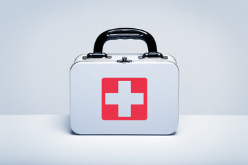 Metal first aid kit on light grey background