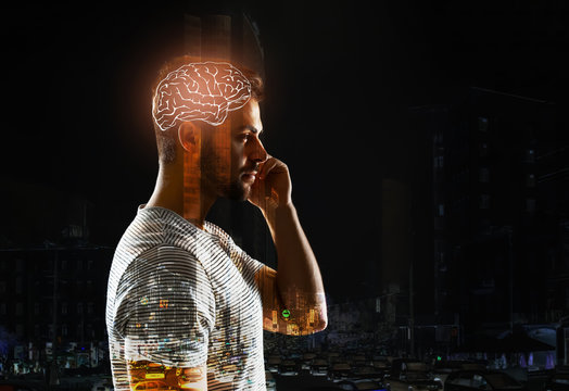 Double exposure of man with glowing brain and city