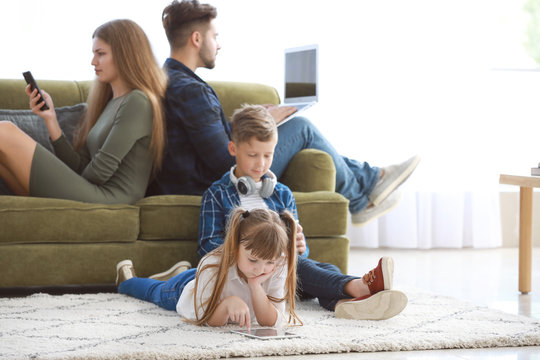 Family addicted to modern technologies with devices at home