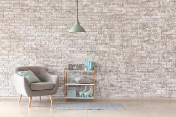 Stylish interior of room near brick wall