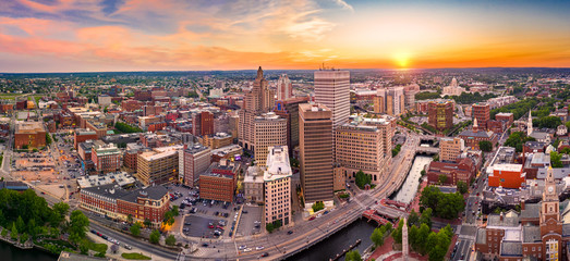 Fotomurales - Aerial panorama of Providence skyline at sunset. Providence is the capital city of the U.S. state of Rhode Island. Founded in 1636 is one of the oldest cities in USA.