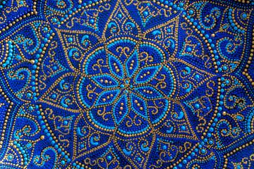 Decorative ceramic plate with blue and golden colors, painted plates, closeup. Decorative porcelain...