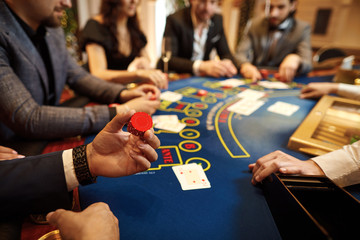 People play poker at the table in the casino.