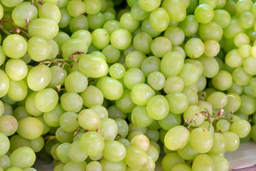 Ripe green-yellow grapes for sale at city farmers market Fototapete