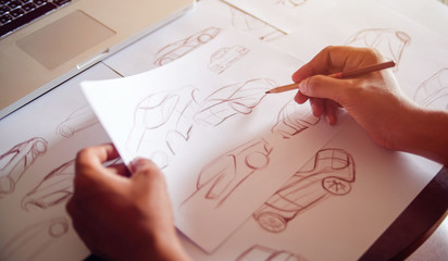 Graphic designer artist Work drawing sketch design development Prototype car Automotive industrial creative visual concept
