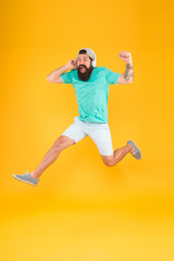 Energy of rhythm. Music fan. Man listen music wireless headphones in motion. Bearded guy enjoy music. Impetuous movement. Hipster dancing jumping headphones gadget. Inspiring song. Music library