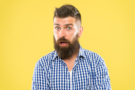 Take care and grow a beard. Surprised hipster with well groomed moustache and beard care. Bearded man surprised with hair care result. Good skin care and healthy lifestyle prevent skin problems