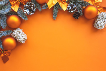 Christmas composition.  Background  orange colors with decorations.