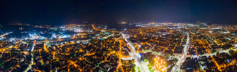 Beauty illuminated at night, a panoramic aerial view to streets in Varna, Bulgaria. Top view