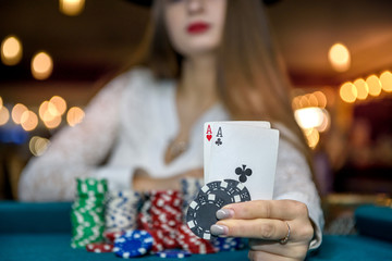 Selective focus on aces combination in female hand