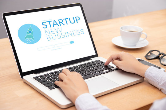 business people working on notebook laptop computer with startup business and rocket logo on screen, start up ideas business development
