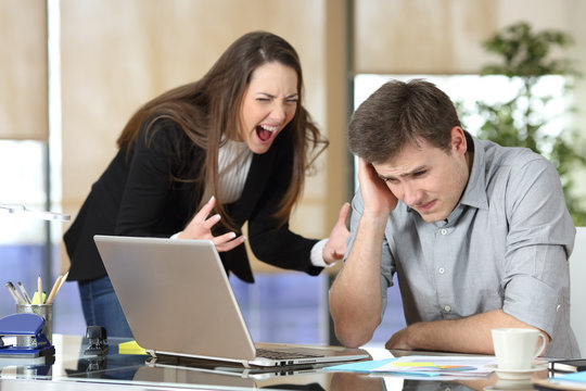 Businesswoman harassing an intern at office