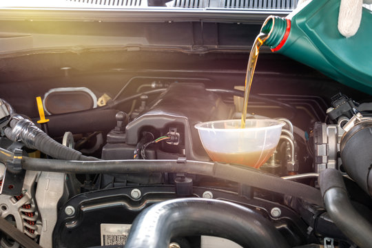 Pouring oil to car engine.Hand mechanic in repairing ,Change the Oil