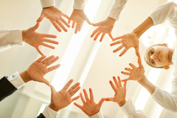 Business children in a circle with outstretched hands