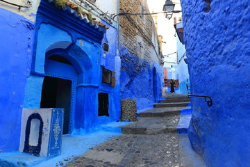 Deurstickers Blue street walls of the popular city of Morocco, Chefchaouen. Traditional moroccan architectural details.