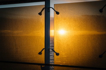 sunset on the sea through a window