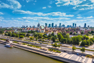 Beautiful panoramic view over the roofs of the Old Town to the Center of Warsaw, the Palace of...