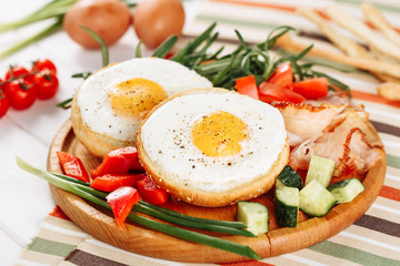 Fried Egg In Hole Toast Vegetable Mix Ham Slices. Spicy Prosciutto Greenery Salad Spring Onion Wooden Board. Sunny- Side Up Platter Healthy Food Closeup Cherry Tomato Rosemary Bunch Closeup Flat Lay