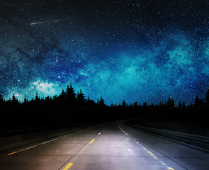 dark night road through forest and starry sky