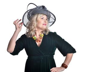 Senior woman wearing black hat isolated on white background