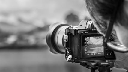 Photographer Setting A Digital Camera
