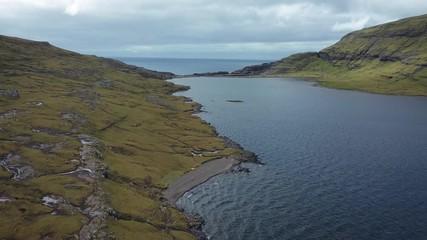 Wall Mural - Flight over the Sorvagsvatn Lake on the island of Vagar in Faroe Islands