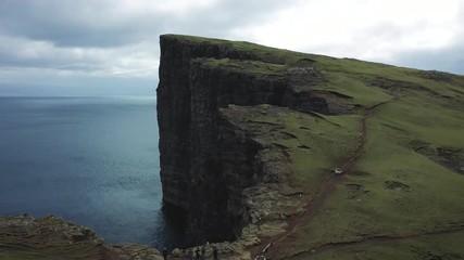 Wall Mural - Flight over the Traelanipa cliff located on the island of Vagar in Faroe Islands