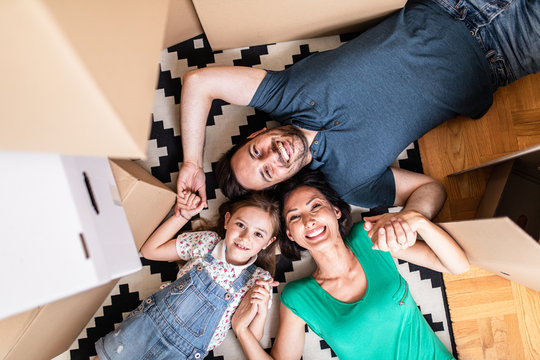 Happy family moving into their new home.