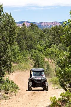 Side by side Utility Vehicle (utv or atv) driving on dirt trail road in Utah