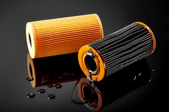 car engine oil filter on dark background
