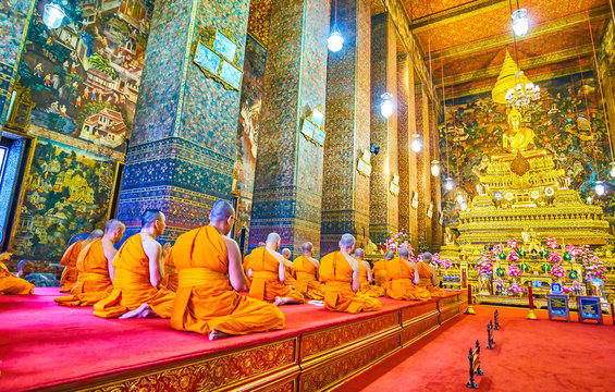The praying in ubosot of Wat Pho complex, Bangkok, Thailand