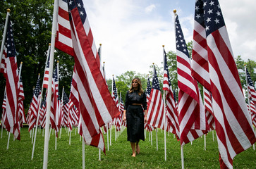 U.S. first lady Melania Trump visits a field of American flags at Ritter Park in Huntington